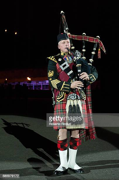 A solo piper of The Massed Pipes and Drums performs 'Rose of Kelvingrove' during the Royal Edinburgh Military Tattoo preview night at Edinburgh...