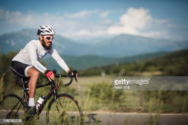 solo ride - road cycling stock pictures, royalty-free photos & images