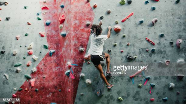 solo session at the climbing centre - mountaineering stock pictures, royalty-free photos & images