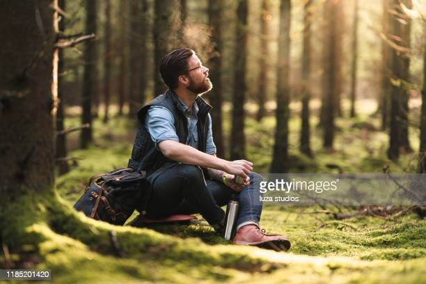 a solo traveler enjoying coffee in the scandinavian nature - one man only stock pictures, royalty-free photos & images