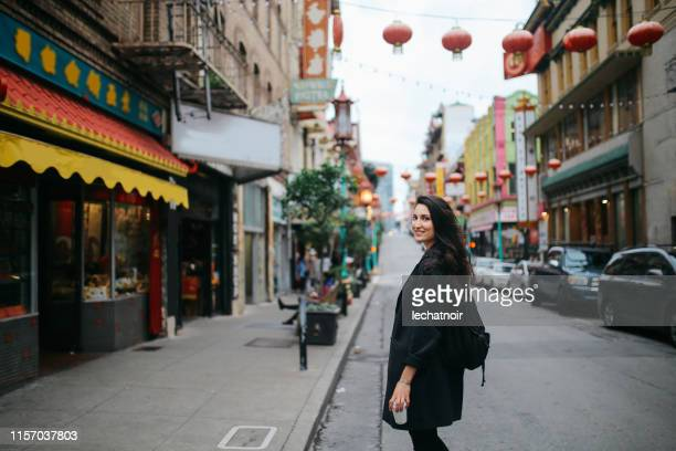 solo traveler in chinatown of san francisco, california - chinatown stock pictures, royalty-free photos & images