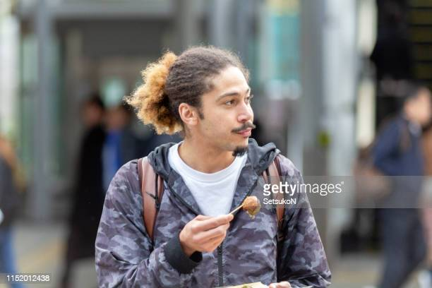 solo traveler in japan - takoyaki stock pictures, royalty-free photos & images