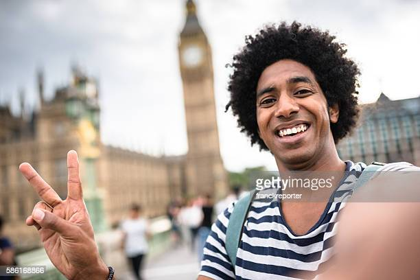 solo traveler in take a selfie on london
