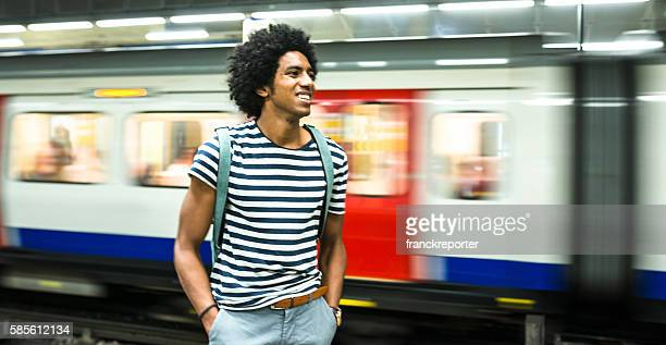 solo traveler on a london station