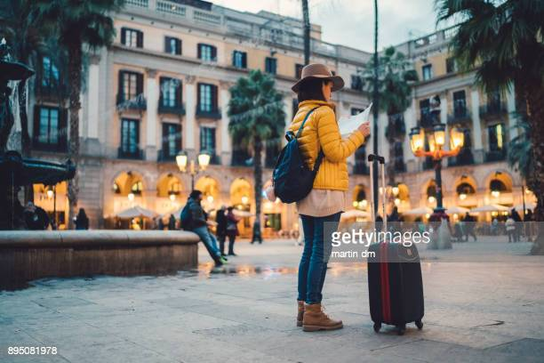 Solo traveler with map at Placa Reial,Barcelona
