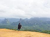 solo traveller enjoying beautiful nature hills