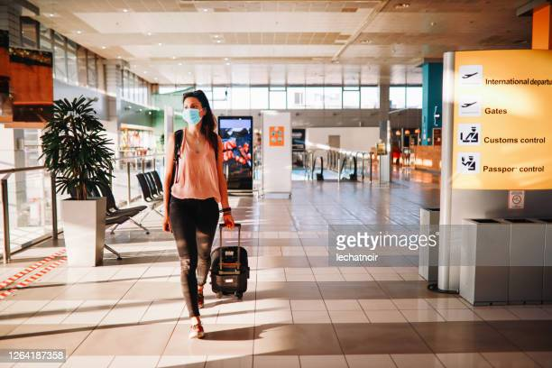 solo traveller in times of the pandemic - airport stock pictures, royalty-free photos & images