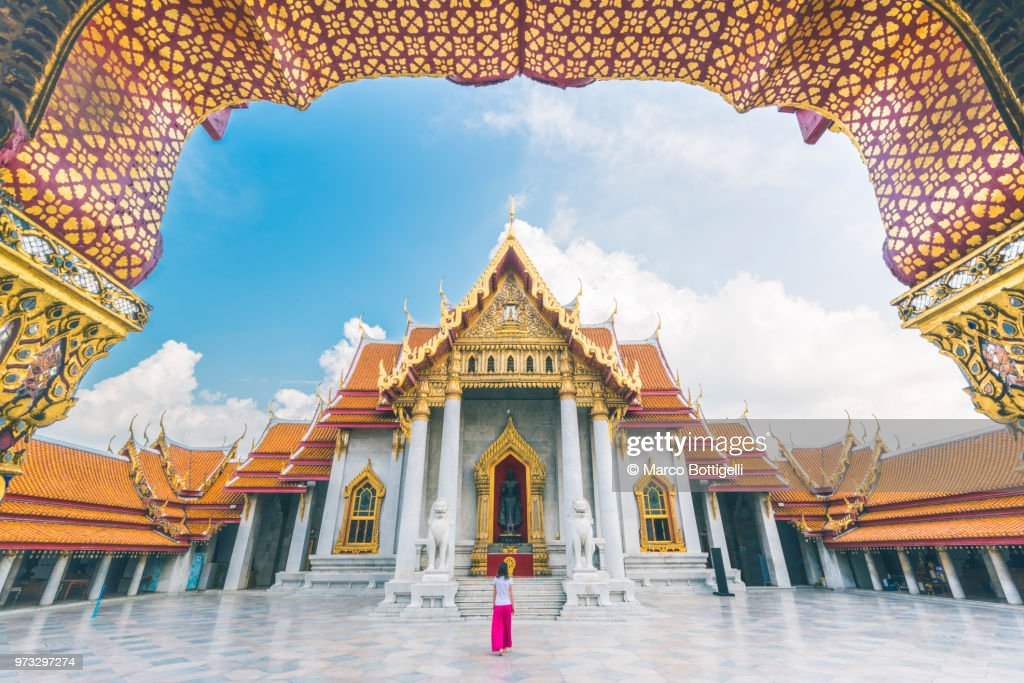 Solo traveller woman walking inside the Wat Benchamabophit temple, Bangkok : Stock Photo