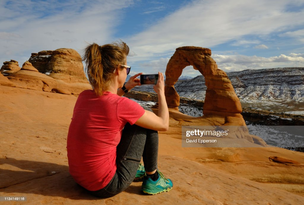Solo Woman Hiking At Delicate Arch In Arches National Park