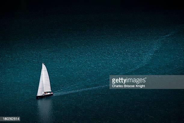 Solo yacht cruises on Lake at St. Moritz