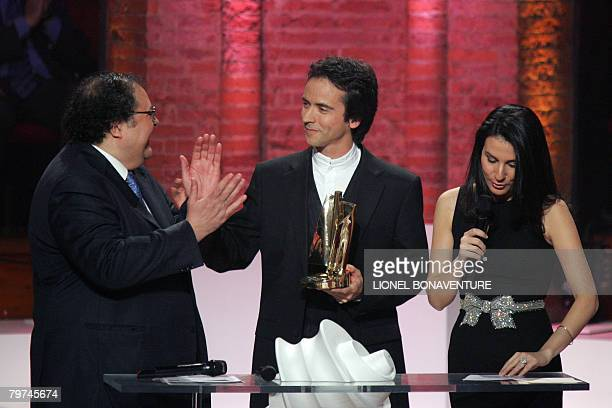 Soloist Jean Guihen Queyras receives the best instrumental soloist of the year award from TV host Marie Drucker and musician Frederic Lodeon during...