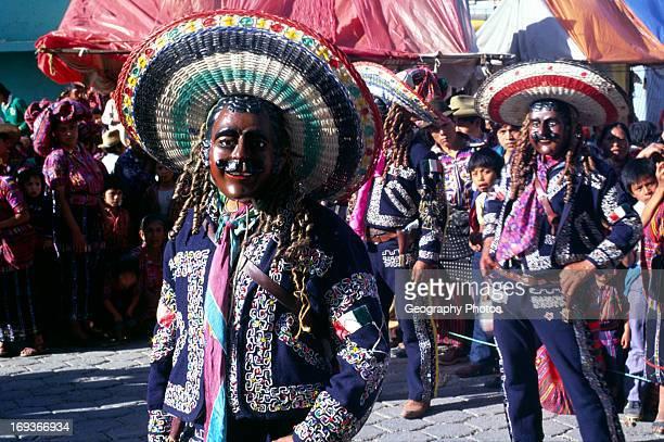 Solola fiesta Guatemala central America Dancers wear masks of Spanish colonizers