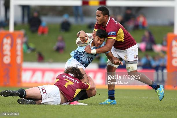 Solomon Alaimalo of Northland is tackled by Tim Boys of Southland during the round three Mitre 10 Cup match between Southland and Northland at Rugby...