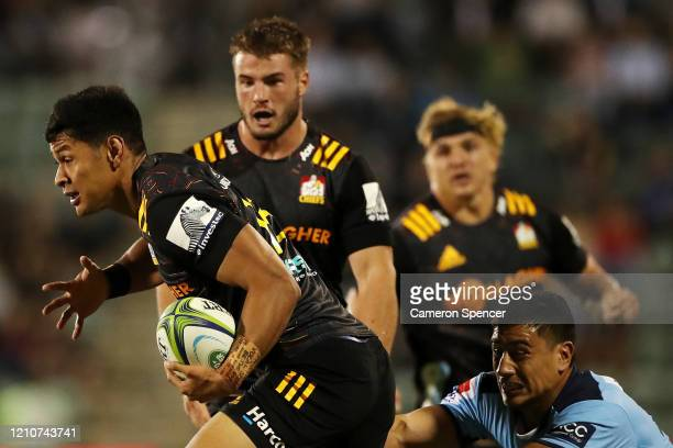 Solomon Alaimalo of the Chiefs is tackled during the round six Super Rugby match between the Waratahs and the Chiefs at WIN Stadium on March 06, 2020...