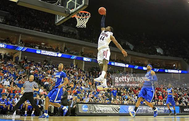 Solomon Hill of the Arizona Wildcats goes up to dunk the ball against the Memphis Tigers during the second round of the 2011 NCAA men's basketball...