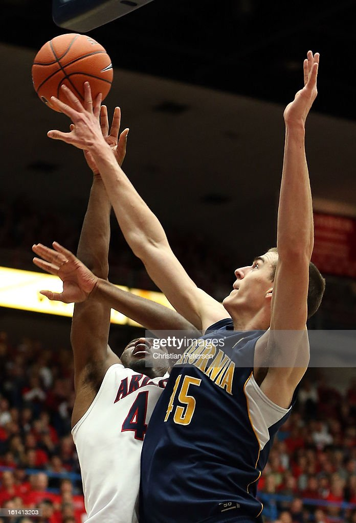 Solomon Hill #44 of the Arizona Wildcats has his shot blocked by David Kravish #45 of the California Golden Bears during the college basketball game at McKale Center on February 10, 2013 in Tucson, Arizona. The Golden Bears defeated the Wildcats 77-69.