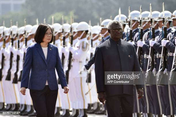 Solomon Islands President Manasseh Sogavare and Taiwan President Tsai Ingwen inspect an honour guard during a welcome ceremony in Taipei on September...