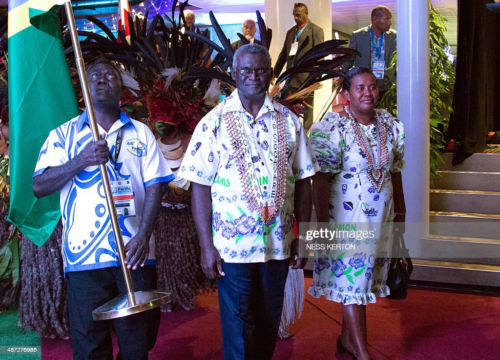 Solomon Islands Prime Minister Manasseh Sogavare (C) arrives for the official opening of the 46th Pacific Islands Forum (PIF) in Port Moresby on September 8, 2015. The 16-nation grouping consists mainly of small island nations, together with Australia and New Zealand, with the two developed nations being accused of dragging their feet on climate change. AFP PHOTO/Ness KERTON