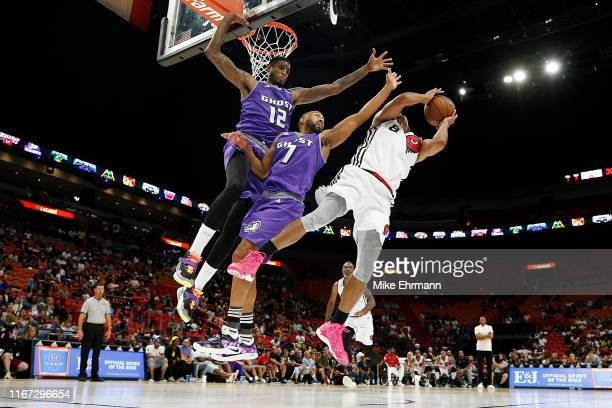 Solomon Jones and Alex Scales of the Ghost Ballers defend a shot by James White of Trilogy during week eight of the BIG3 three on three basketball...
