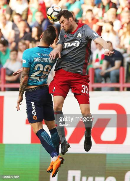Solomon Kvirkvelia of FC Lokomotiv Moscow vie for the ball with Anton Zabolotny of FC Zenit Saint Petersburg during the Russian Football League match...