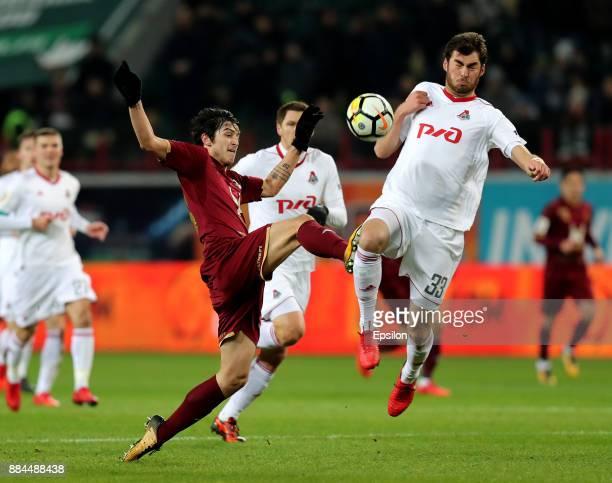 Solomon Kvirkvelia of FC Lokomotiv Moscow vies for the ball with Sardar Azmoun of FC Rubin Kazan during the Russian Premier League match between FC...