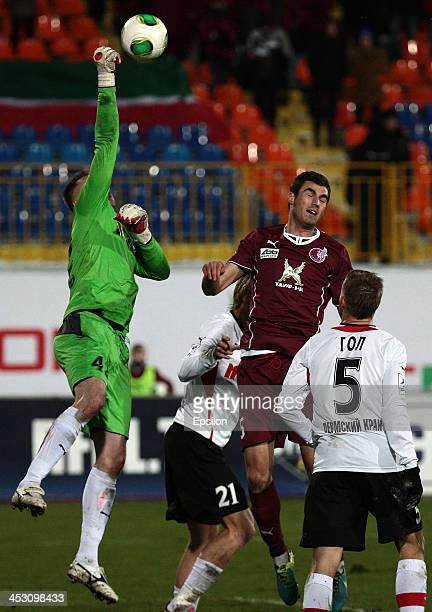 Solomon Kvirkvelia of FC Rubin Kazan is challenged by Sergei Narubin of FC Amkar Perm during the Russian Football League Championship match between...
