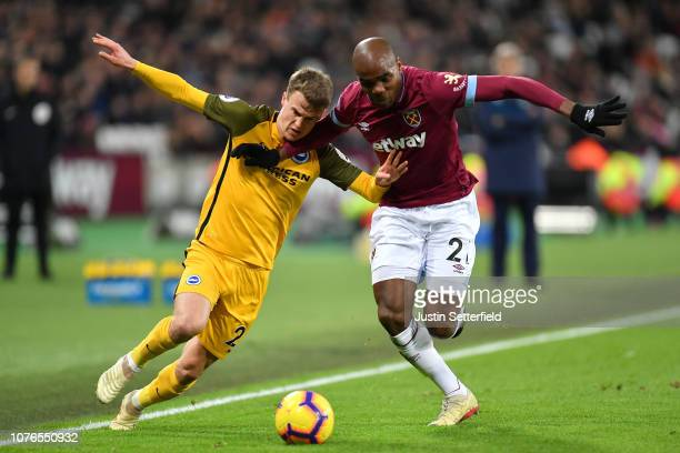 Solomon March of Brighton and Hove Albion battles for possession with Angelo Ogbonna of West Ham United during the Premier League match between West...