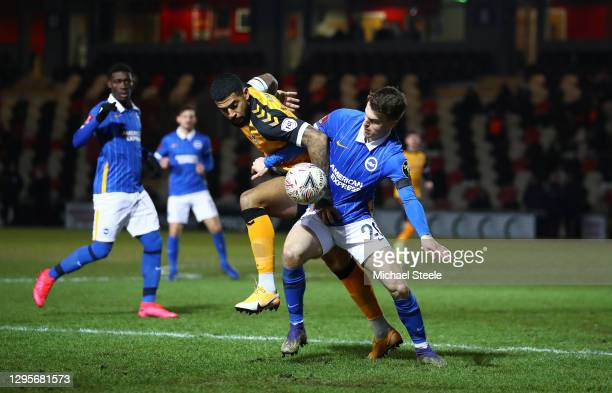 Solomon March of Brighton and Hove Albion battles for possession with Joss Labadie of Newport County during the FA Cup Third Round match between...