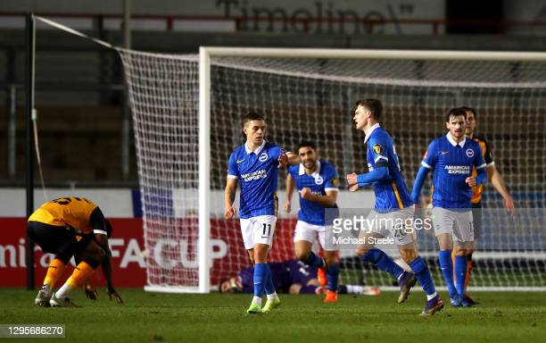 Solomon March of Brighton and Hove Albion celebrates with teammate Leondro Trossard after scoring their team's first goal during the FA Cup Third...