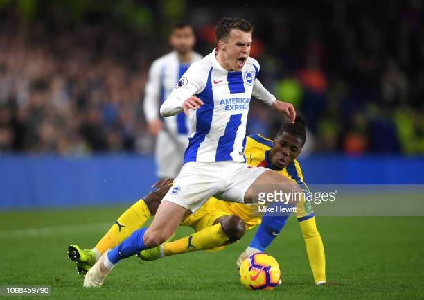 Solomon March of Brighton and Hove Albion is fouled by Wilfried Zaha of Crystal Palace during the Premier League match between Brighton Hove Albion...
