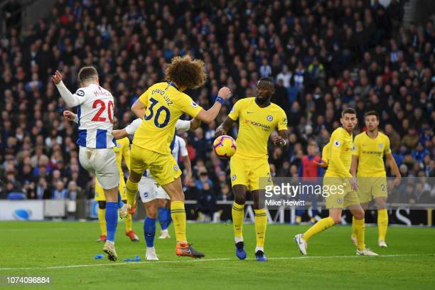 Solomon March of Brighton and Hove Albion scores his team's first goal during the Premier League match between Brighton Hove Albion and Chelsea FC at...