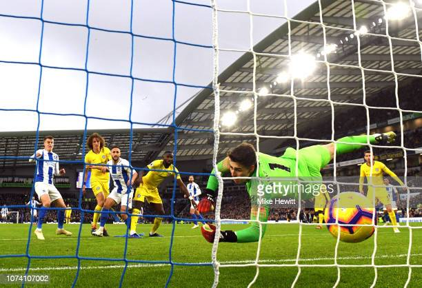 Solomon March of Brighton and Hove Albion scores his team's first goal past Kepa Arrizabalaga of Chelsea during the Premier League match between...