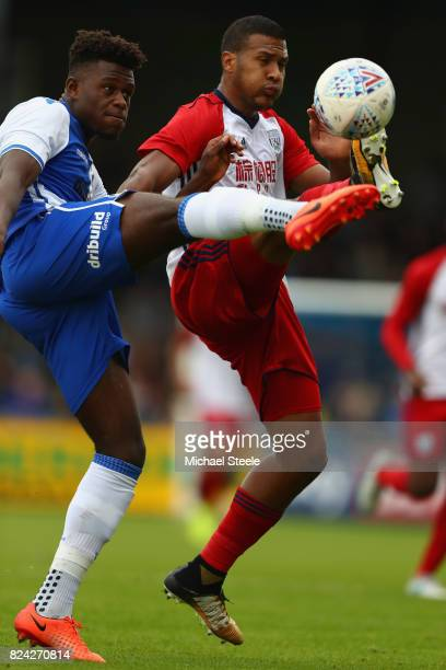 Solomon Rondon of West Bromwich Albion challenges Rollin Menayese of Bristol Rovers during the pre season match between Bristol Rovers and West...