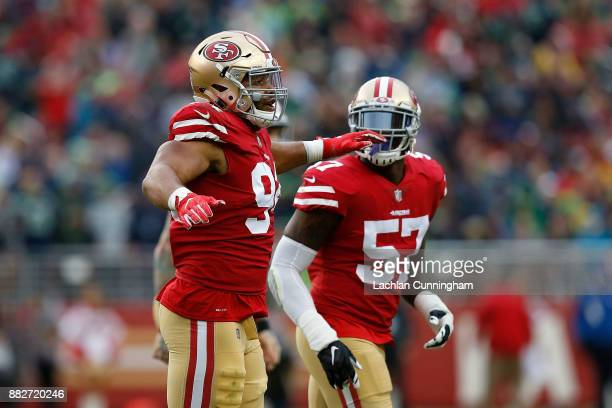 Solomon Thomas and Eli Harold of the San Francisco 49ers celebrate after the Seattle Seahawks missed a field goal attempt at Levi's Stadium on...