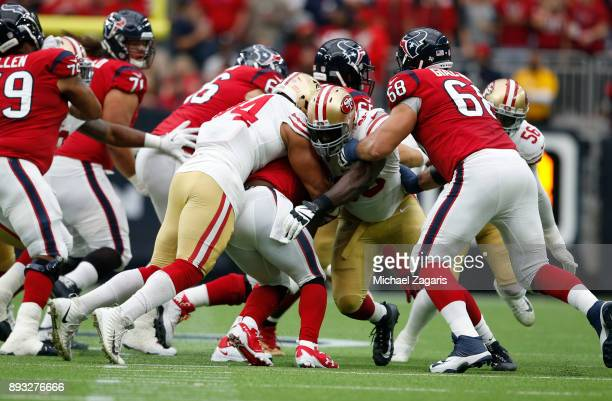 Solomon Thomas and Reuben Foster of the San Francisco 49ers stop TJ Yates of the Houston Texans during the game at NRG Stadium on December 10 2017 in...
