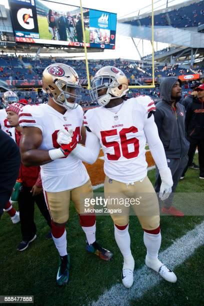 Solomon Thomas and Reuben Foster of the San Francisco 49ers talk on the field prior to the game against the Chicago Bears at Soldier Field on...
