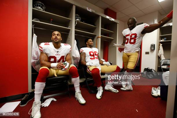 Solomon Thomas DeForest Buckner and Elvis Dumervil of the San Francisco 49ers relax in the locker room prior to the game against the Los Angeles Rams...