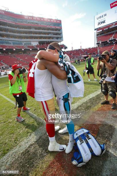 Solomon Thomas of the San Francisco 49ers and Christian McCaffrey of the Carolina Panthers embrace on the field following the game at Levi's Stadium...