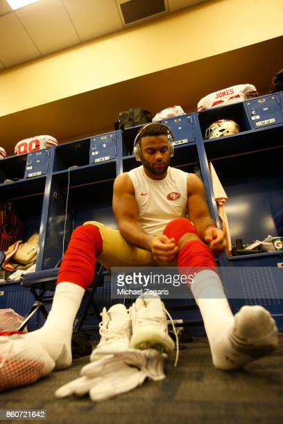 Solomon Thomas of the San Francisco 49ers gets dressed in the locker room prior to the game against the Indianapolis Colts at Lucas Oil Stadium on...