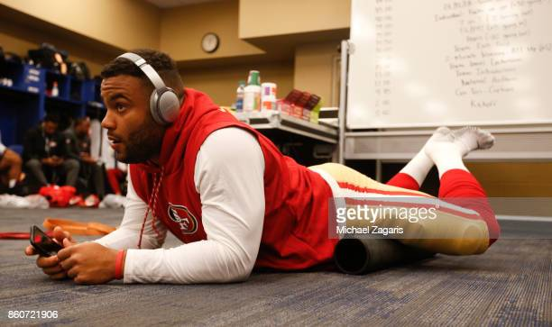 Solomon Thomas of the San Francisco 49ers listens to music in the locker room prior to the game against the Indianapolis Colts at Lucas Oil Stadium...
