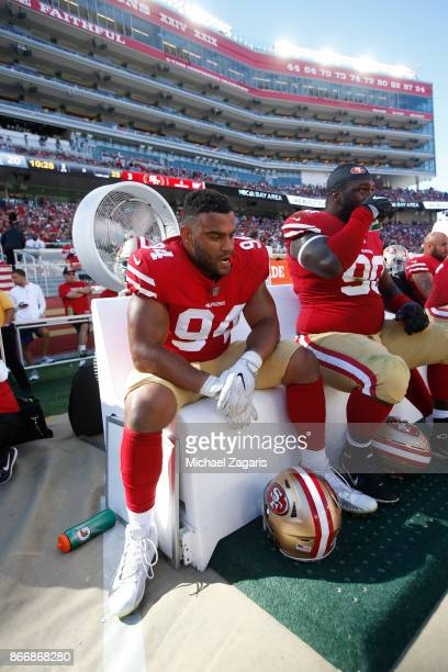 Solomon Thomas of the San Francisco 49ers sits on the sideline during the game against the Dallas Cowboys at Levi's Stadium on October 22 2017 in...