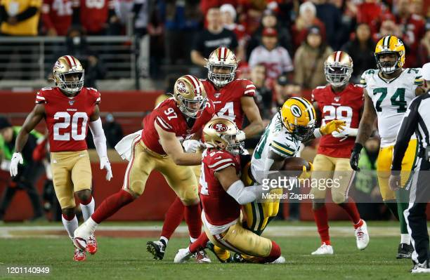 Solomon Thomas of the San Francisco 49ers tackles Jamaal Williams of the Green Bay Packers during the game at Levi's Stadium on January 19 2020 in...