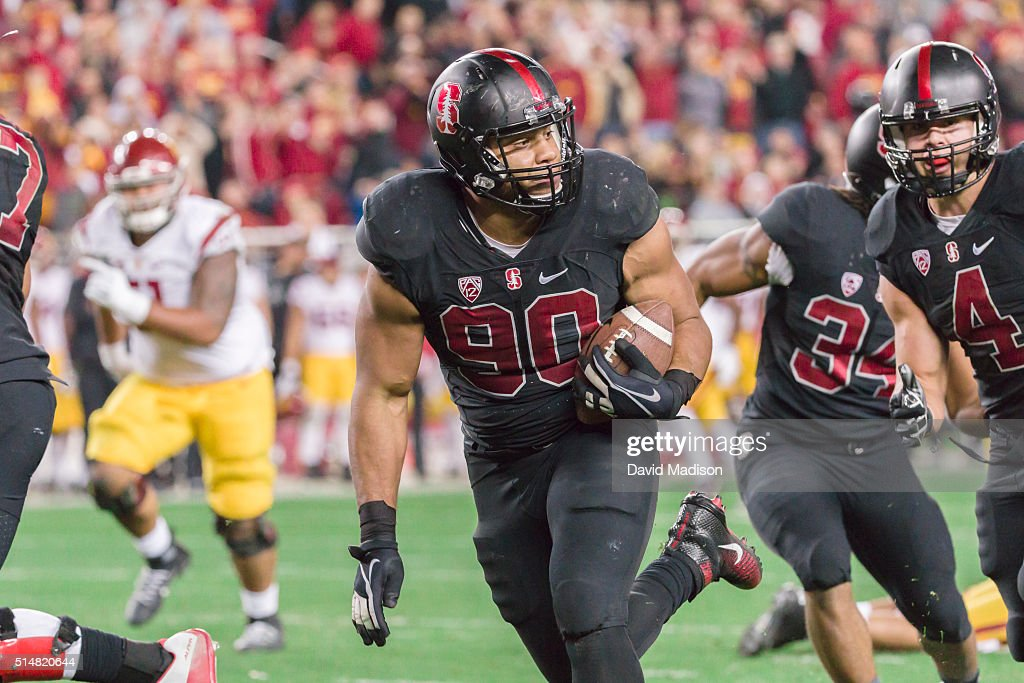 Solomon Thomas #90 of the Stanford Cardinal runs back a fumble during the Pac-12 Championship Game against the USC Trojans played on December 5, 2015 at Levi's Stadium in Santa Clara, California.