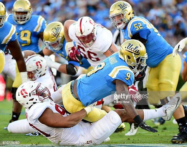 Solomon Thomas of the Stanford Cardinal tackles Dymond Lee of the UCLA Bruins for a loss during the first quarter at Rose Bowl on September 24 2016...