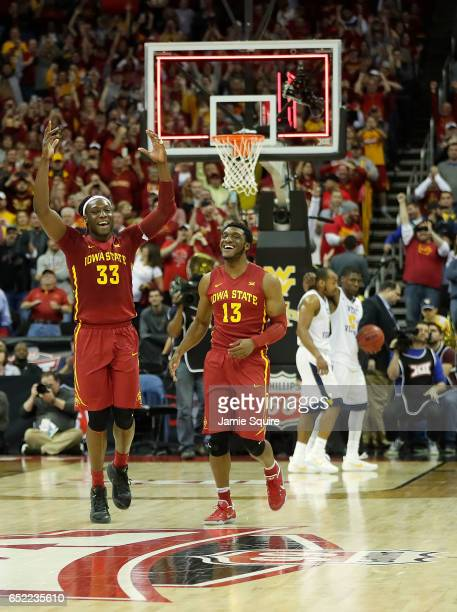 Solomon Young and Jakolby Long of the Iowa State Cyclones celebrate as they defeat the West Virginia Mountaineers to win the championship game of the...