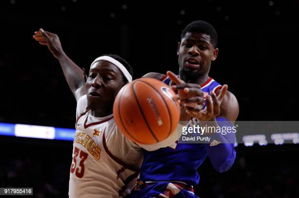 Solomon Young of the Iowa State Cyclones battles for a rebound with Malik Newman of the Kansas Jayhawks n the first half of play at Hilton Coliseum...