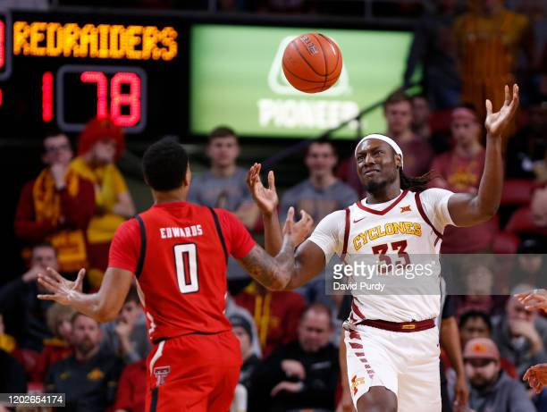 Solomon Young of the Iowa State Cyclones battles for the ball with Kyler Edwards of the Texas Tech Red Raiders in the second half of the play at...