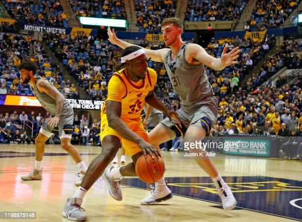 Solomon Young of the Iowa State Cyclones drives the baseline against Logan Routt of the West Virginia Mountaineers at the WVU Coliseum on February 5...