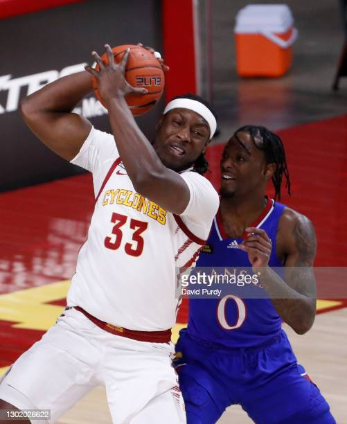 Solomon Young of the Iowa State Cyclones pulls in a rebound as Marcus Garrett of the Kansas Jayhawks defends in the first half of play at Hilton...