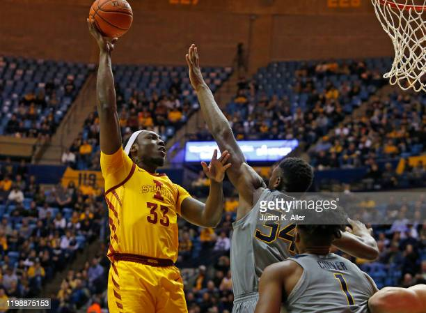 Solomon Young of the Iowa State Cyclones pulls up for a shot against Oscar Tshiebwe of the West Virginia Mountaineers at the WVU Coliseum on February...